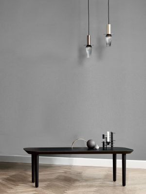Image of Lindebjerg Design Dark Oak T40 table in a gray colored room with interior